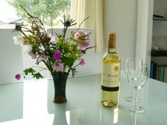 The dining room with flowers and wine on the table