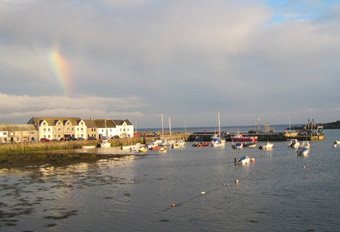 Isle of Whithorn harbour with rainbow
